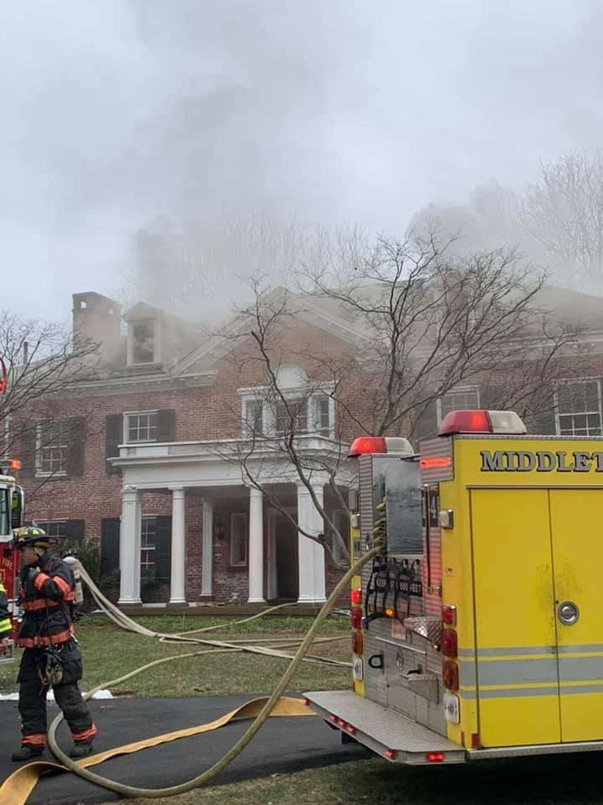 Fire units on scene for an attic fire in Middletown, Conn., on Monday, Jan. 11, 2021.