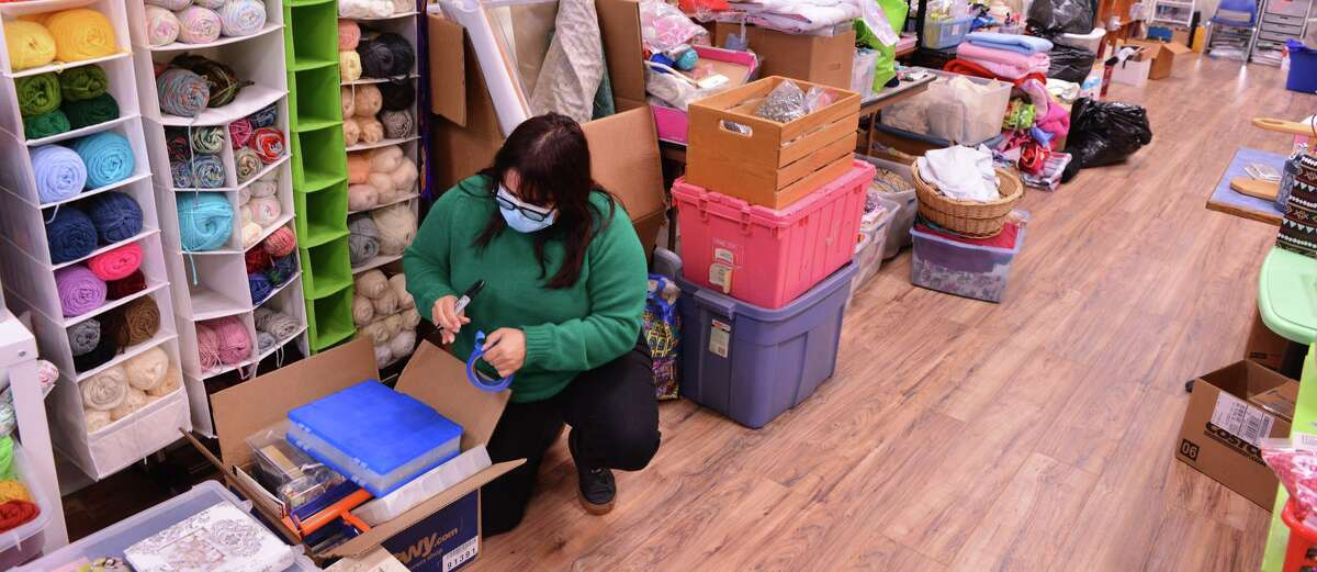 Mary Elizabeth Cantu, founder and executive director of Spare Parts, checks donations at the nonprofit's new brick-and-mortar shop, the Spare Parts Center for Creative Reuse.