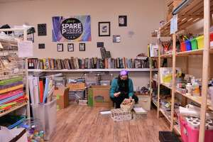 Volunteer Maggie Peachey checks in some of a 450-pound donation of art and craft supplies at the Spare Parts Center for Creative Reuse.