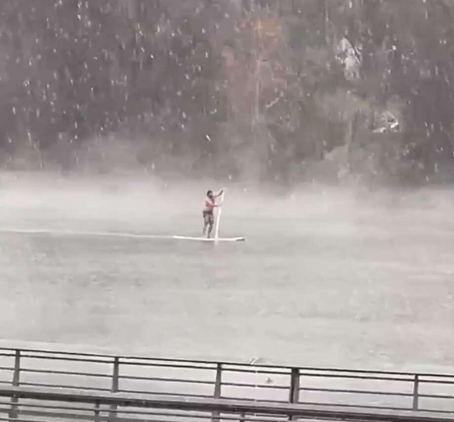 "An Austin man is living up to the city's well-known slogan, ""Keep Austin Weird,"" after he paddleboard shirtless on Lady Bird Lake during Sunday's snow. Photo: 365thingsaustin"