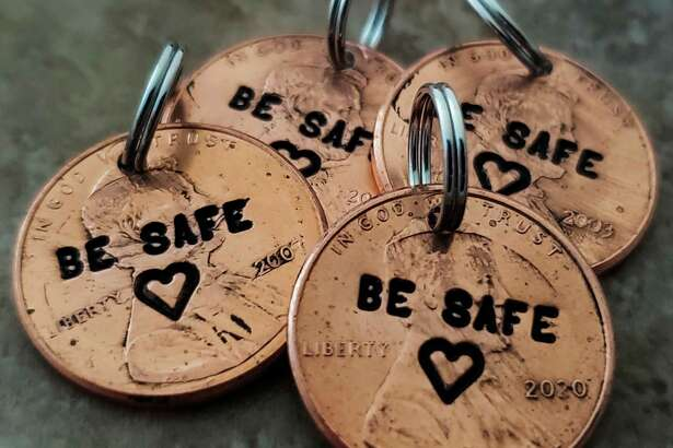 """Stamped pennies made by Tiffany Demski of Auburn Hills, 10, are stamped with the message """"Be safe."""" (Photo provided/Angee Demski)"""