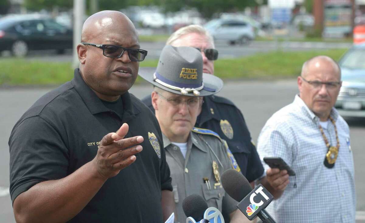 Police Chief Patrick Ridenhour speaks at a press conference, in the I-84 exit 2 commuter parking lot, about an officer involved shooting that happened Wednesday morning in the area. July 3, 2019, in Danbury, Conn.