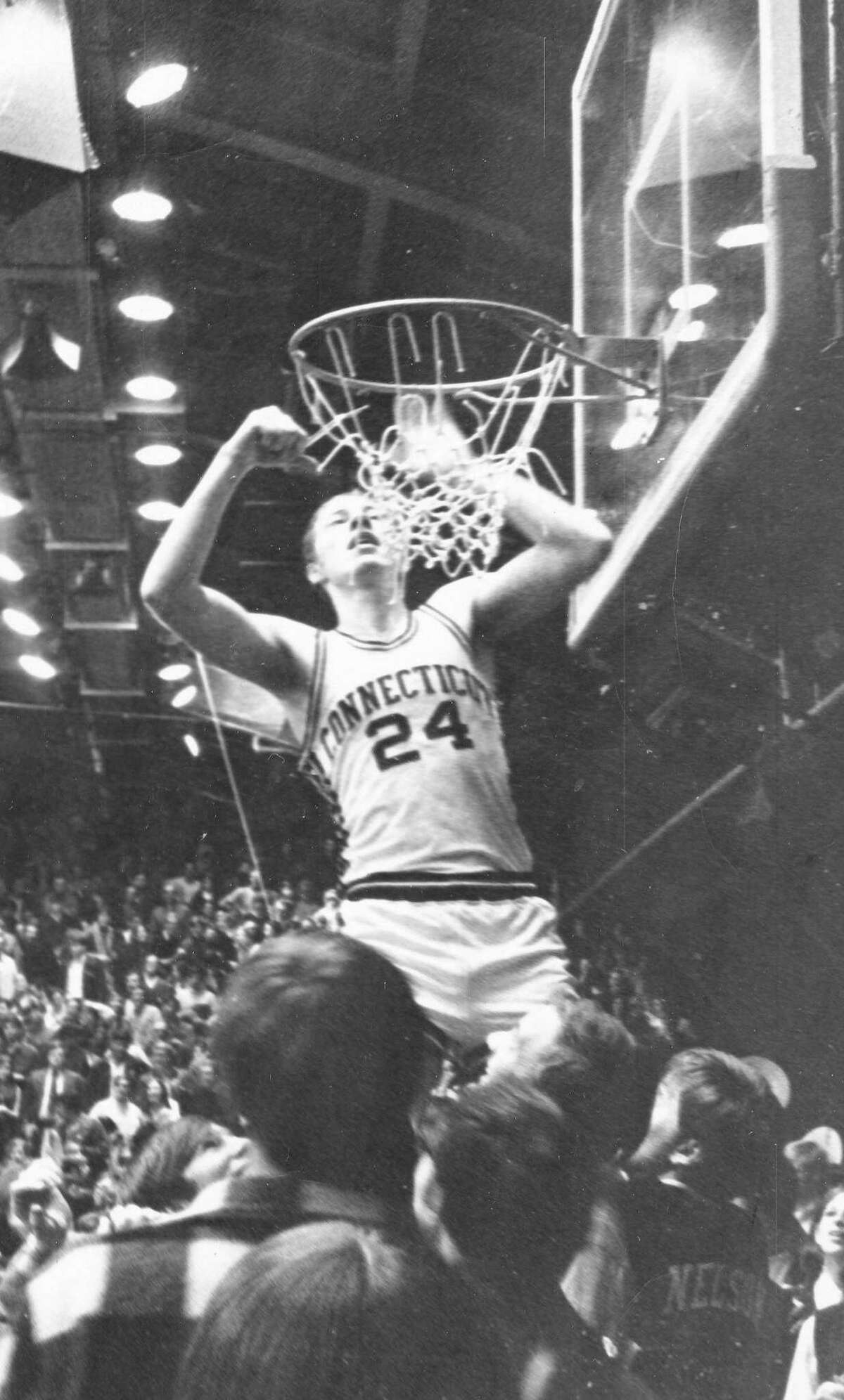 Connecticut's Bob Staak cuts down the nets after the Huskies beat Rhode Island 35-32 to win the 1969-70 Yankee Conference title. Staak averaged 18.1 points over three seasons fro the Huskies.