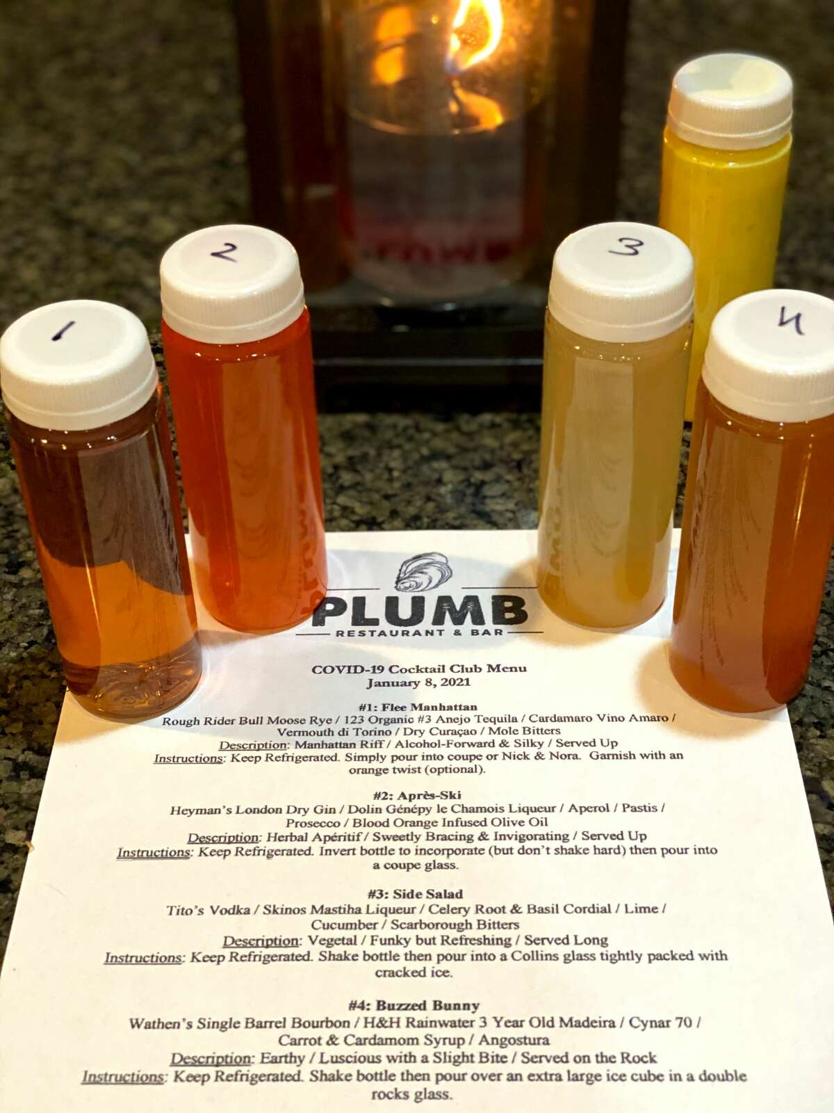 The monthlong cocktail subscription program from Plumb Oyster Bar in Troy includes four bottled cocktails each week for four weeks.(Photo by Susie Davidson Powell.)