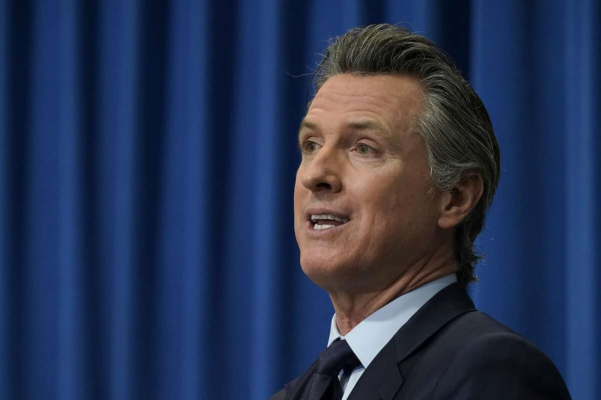 California Gov. Gavin Newsom outlines his 2021-2022 state budget proposal during a news conference in Sacramento, Calif., Friday, Jan. 8, 2021.