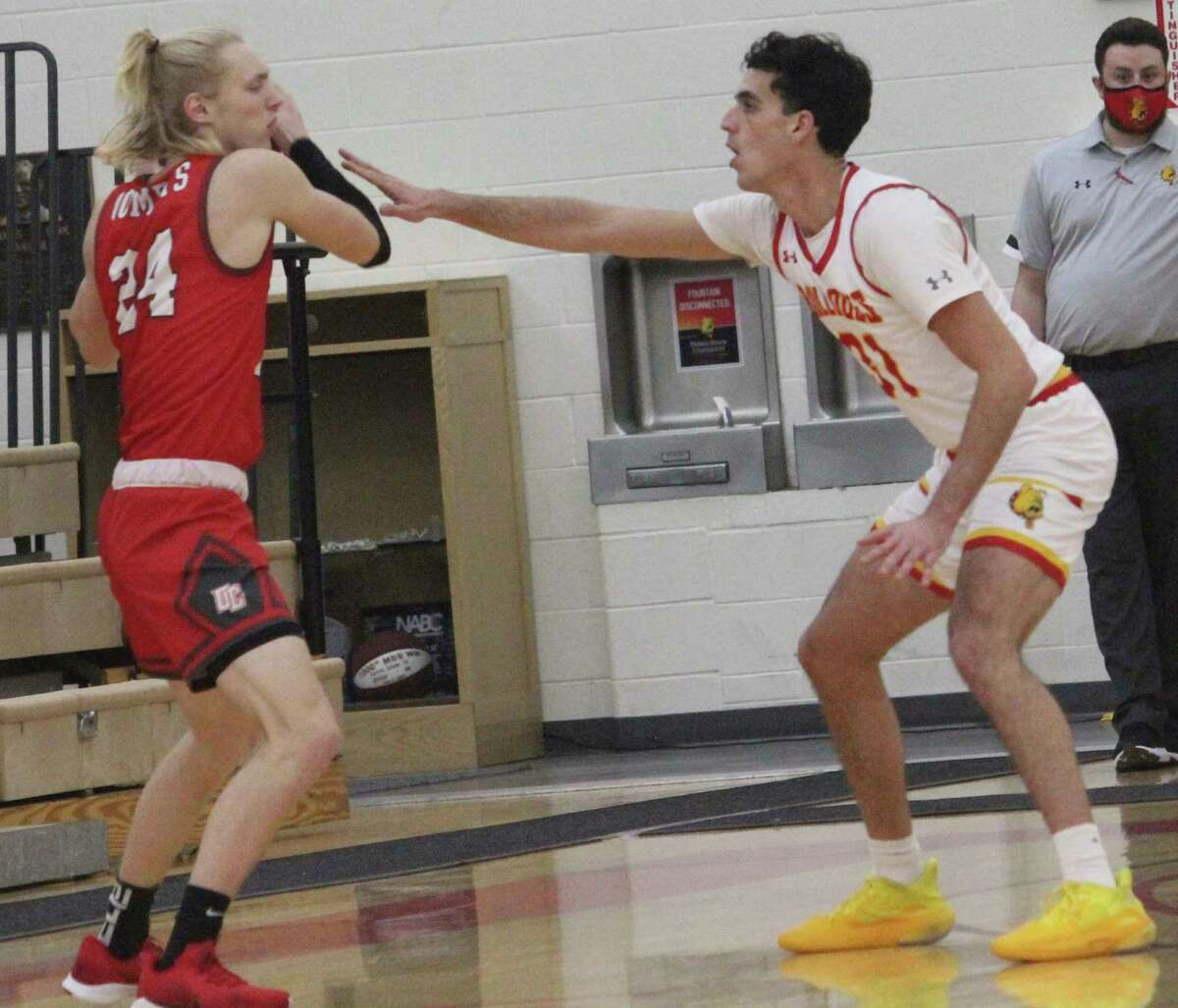 Ferris State's Michael Peterson (right) guards Olivet College's Britton Angell, formerly of Crossroads Charter Academy, at a basketball game in Wink Arena last month. (Pioneer photo/John Raffel)