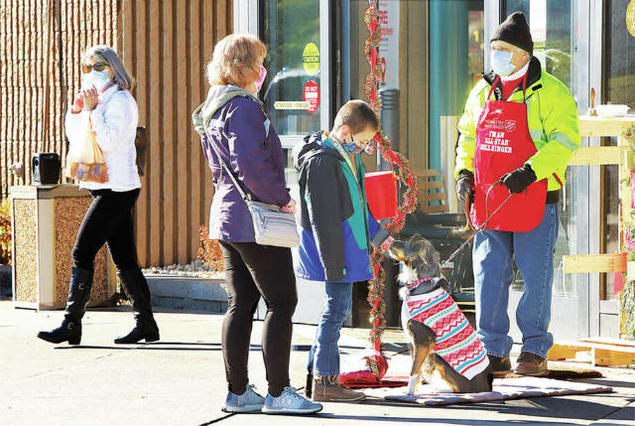 Molly, the rescue dog of Salvation Army bell ringer Mike Cleary, attracted attention atr the collection station outside the Godfrey Schnuck's grocery store this year. Officials said this year's campaign surpassed its goal and received a gold coin in a red kettle in Wood River.