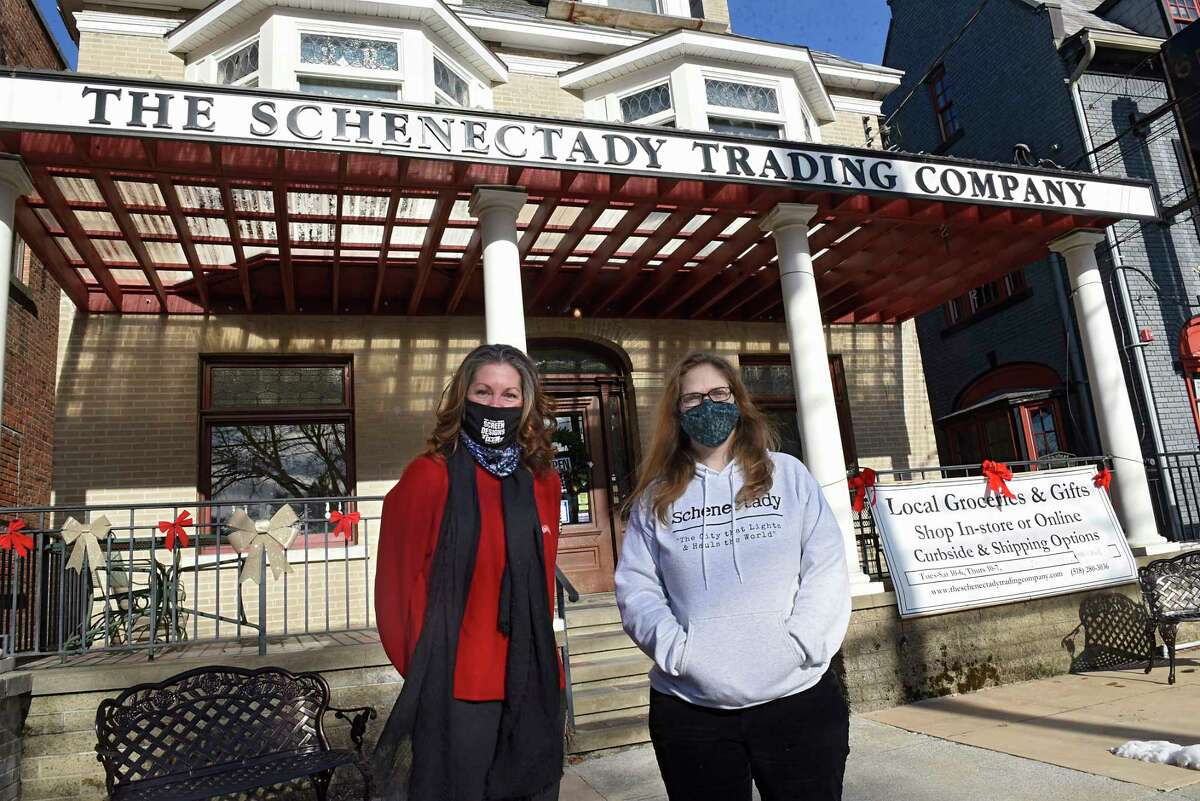 Adine Viscusi of Casa Visco and Schenectady Trading Company owner Caroline Bardwell stand outside Schenectady Trading Company on Friday, Jan. 8, 2021 in Schenectady, N.Y. Viscusi sells Casa Visco products in the co-op. (Lori Van Buren/Times Union)