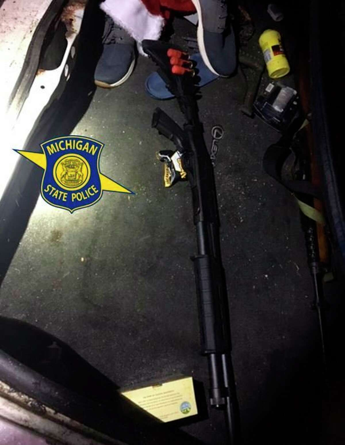 Police found three unloaded long guns in the trunk of a Lansing man's vehicle after responding to a car-deer collision call and finding the car's owner in the road and wielding a machete. (Courtesy Photo)