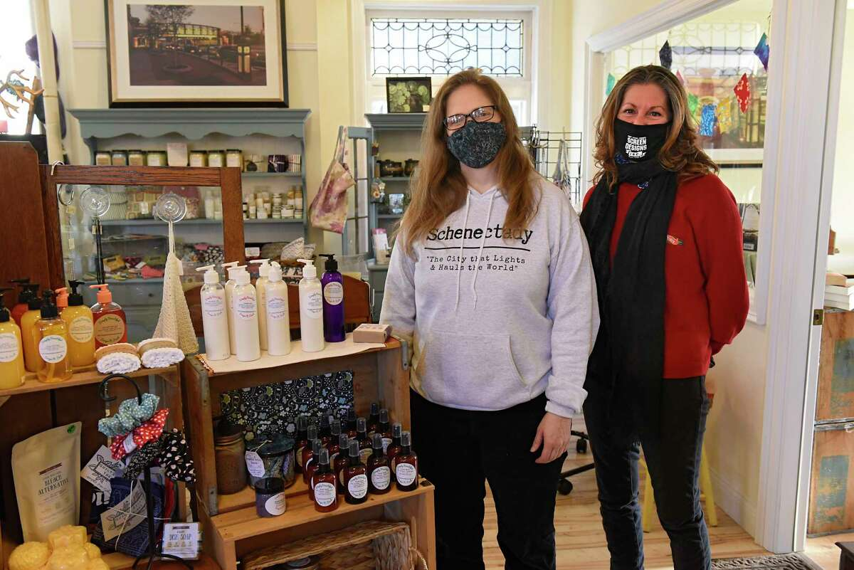 Schenectady Trading Company owner Caroline Bardwell and Adine Viscusi of Casa Visco stand inside Schenectady Trading Company on Friday, Jan. 8, 2021 in Schenectady, N.Y. Viscusi sells Casa Visco products in the co-op. (Lori Van Buren/Times Union)
