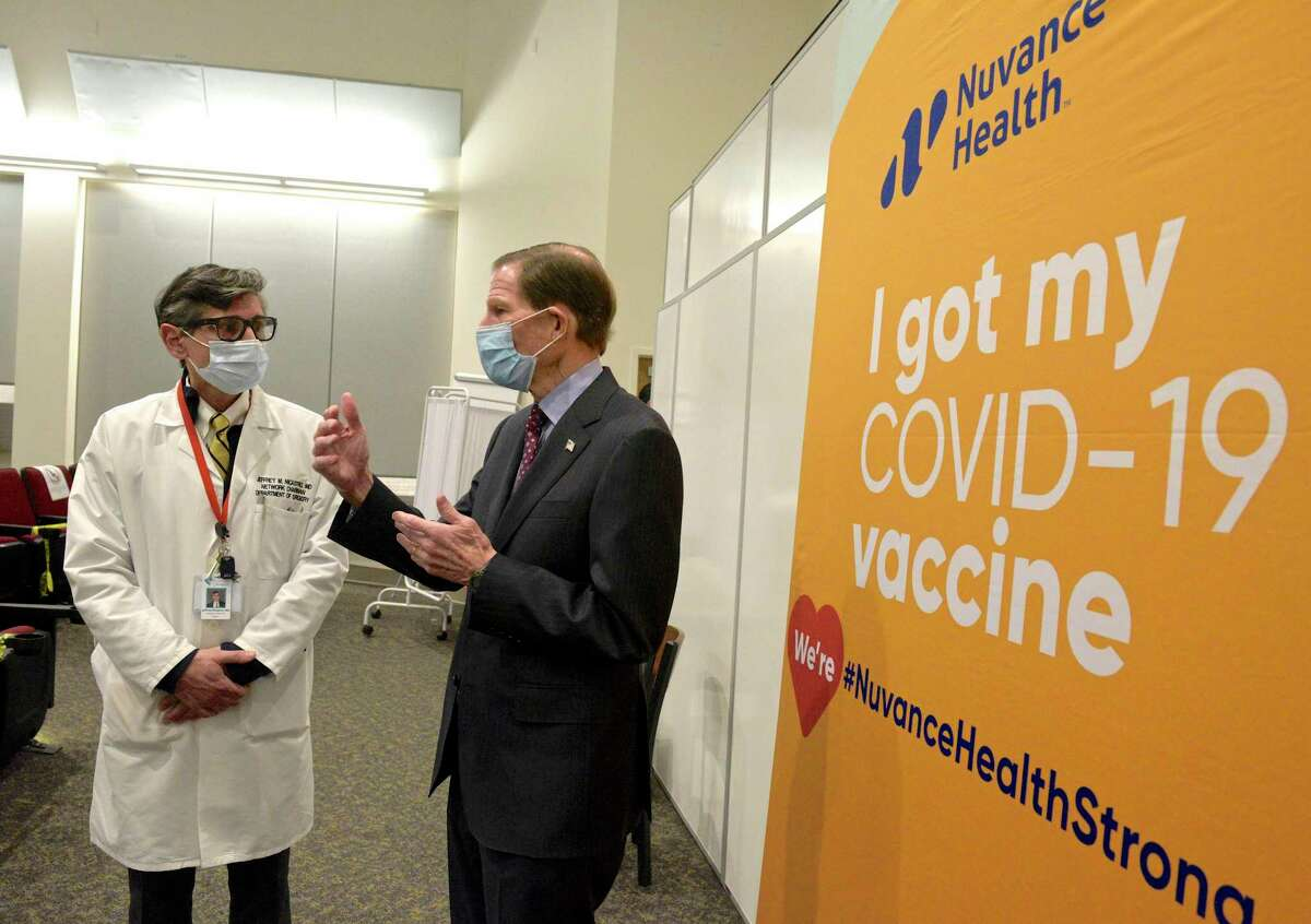 U.S. Senator Richard Blumenthal, right, talks with Jeffrey Nicastro MD, Chief Medical Officer of Nuvance Health at Danbury Hospital on Tuesday afternoon. Blumenthal was visiting the hospital to view their COVID-19 vaccination station. January 12, 2021, in Danbury, Conn.