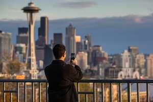 SEATTLE, WA - NOVEMBER 4: The sun sets on the Space Needle and downtown skyline as viewed from Queen Anne Hill on November 4, 2015, in Seattle, Washington. Seattle, located in King County, is the largest city in the Pacific Northwest, and is experiencing an economic boom as a result of its European and Asian global business connections. (Photo by George Rose/Getty Images)