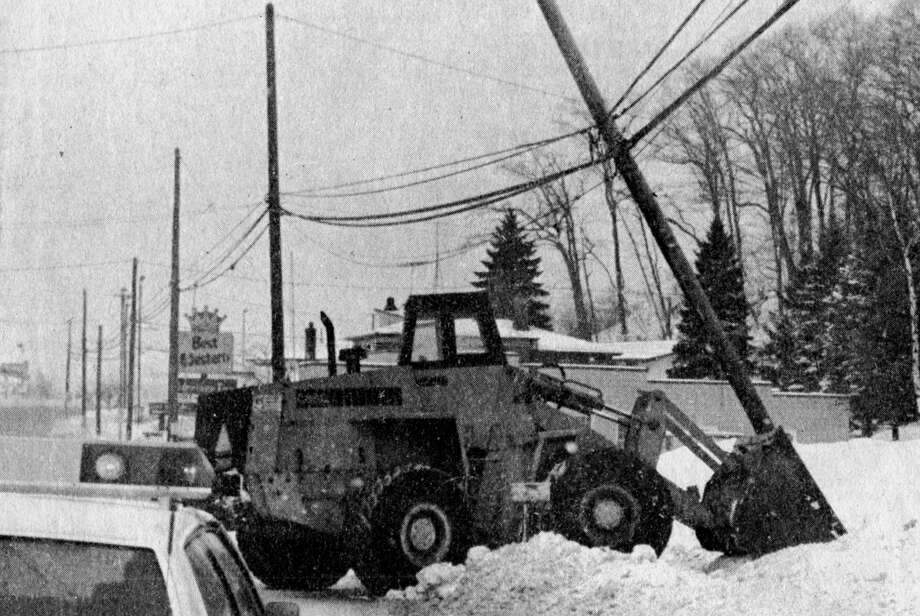 On the morning of Jan. 14, 1981, a front-end loader hit a utility pole on U.S. 31 near Peanut Junction. The photo was published on the front page of the News Advocate 40 years ago. (Manistee County Historical Museum photo)