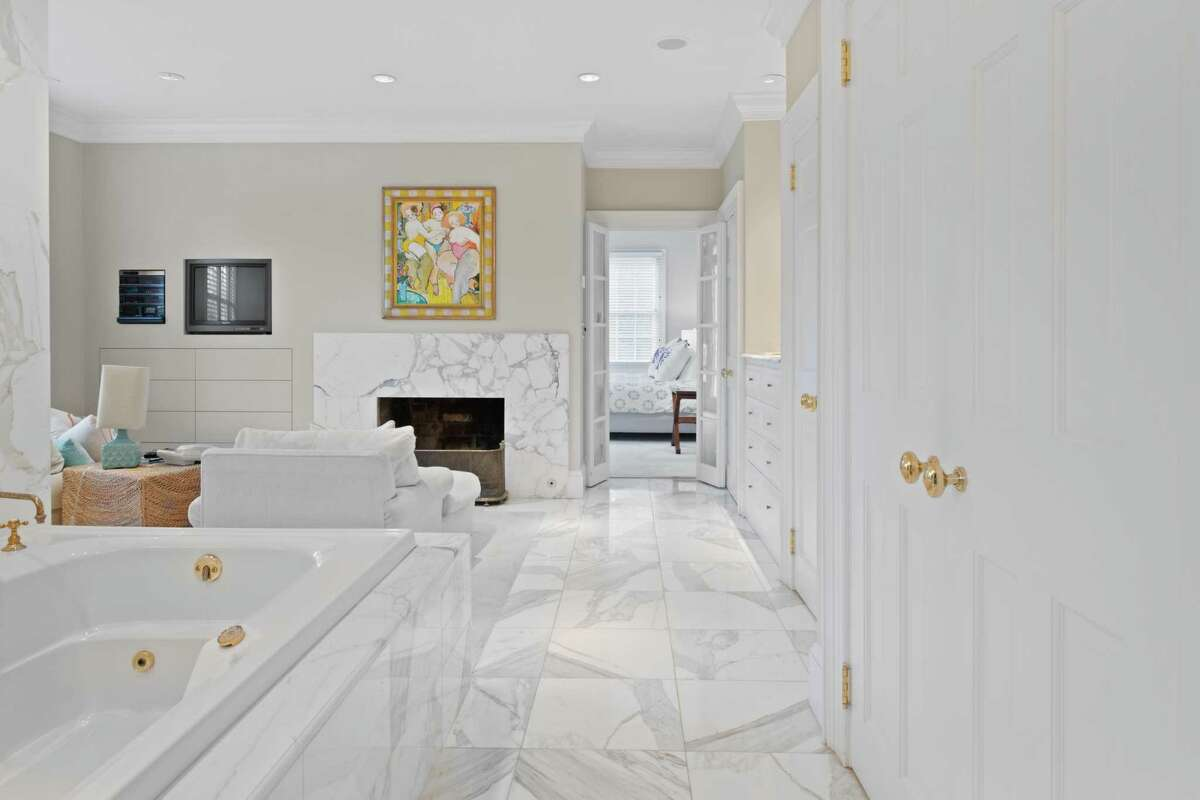 Luxurious master bath with sitting area and fireplace at 77 Morningside Drive South, Westport.