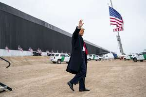President Donald Trump waves while touring a portion of the border wall with Mexico, near Alamo, Texas, on Tuesday, Jan. 12, 2021. (Doug Mills/The New York Times)