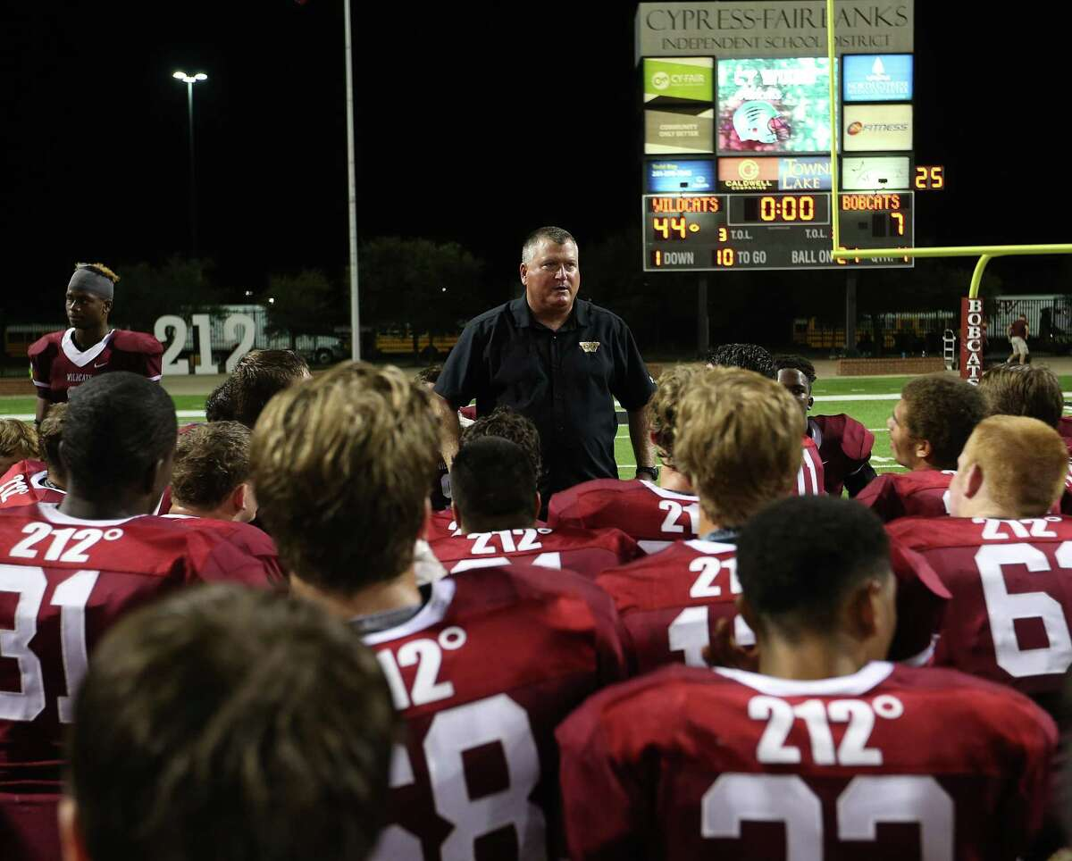 Cypress Woods' head coach Trent Faith talks to his team after their 44-7 win over Cy-Fair on Thursday, Oct. 22, 2015, in Cypress.