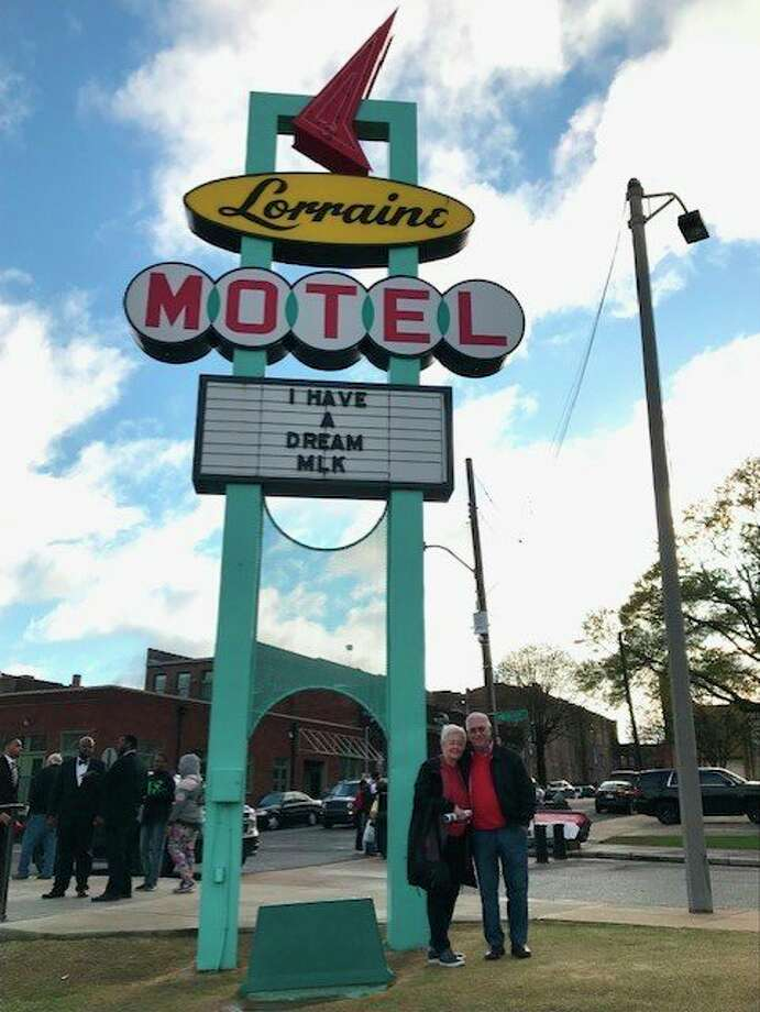 Linda and Dick Albee stand by the sign for the Lorraine Motel, where Dr. Martin Luther King Jr. was killed. The motel is now part of the National Civil Rights Museum. (Courtesy photo/Dick and Linda Albee)