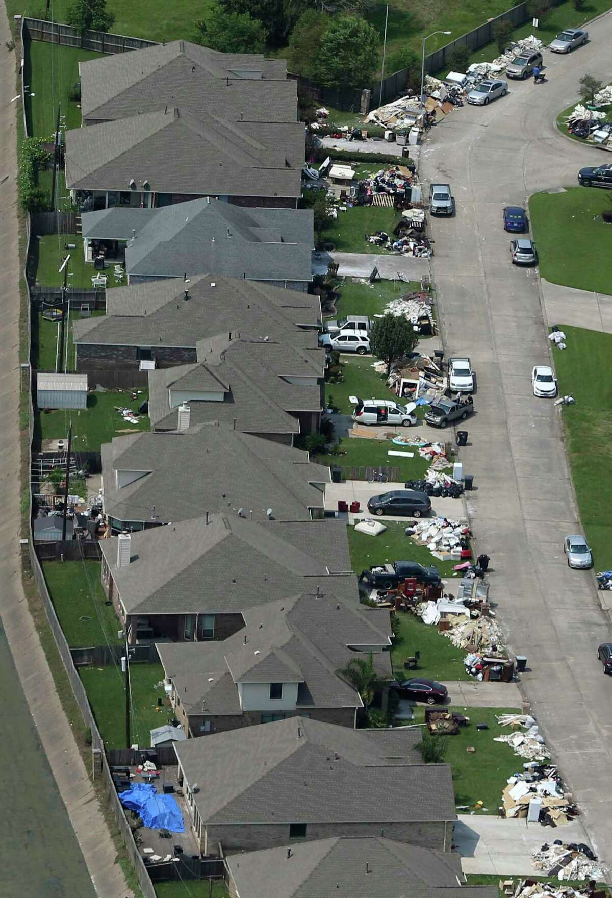 Piles of debris are seen Wednesday, Sept. 6, 2017 in front of Beaumont-area homes as residents try to salvage what they can after Hurricane Harvey flooded much of the area.