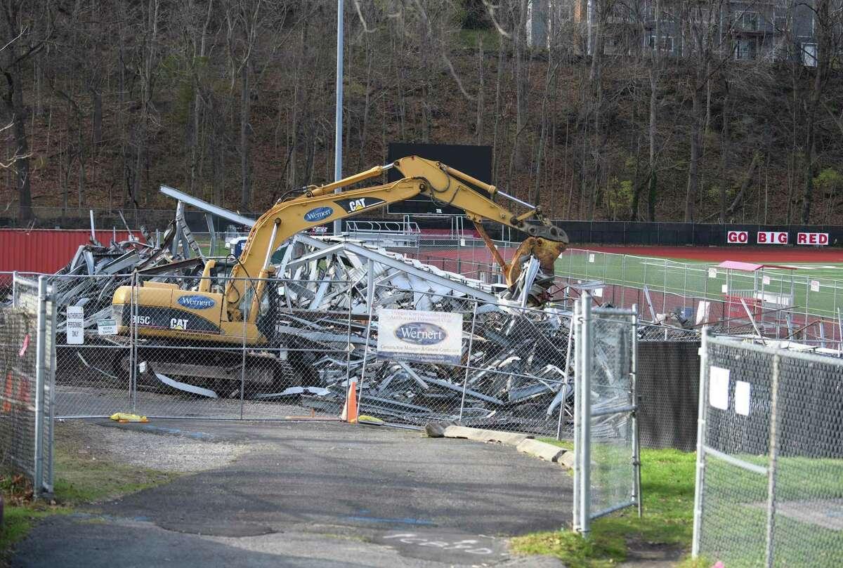 The Cardinal Stadium bleachers are torn down at Greenwich High School in Greenwich, Conn. Tuesday, Dec. 8, 2020.
