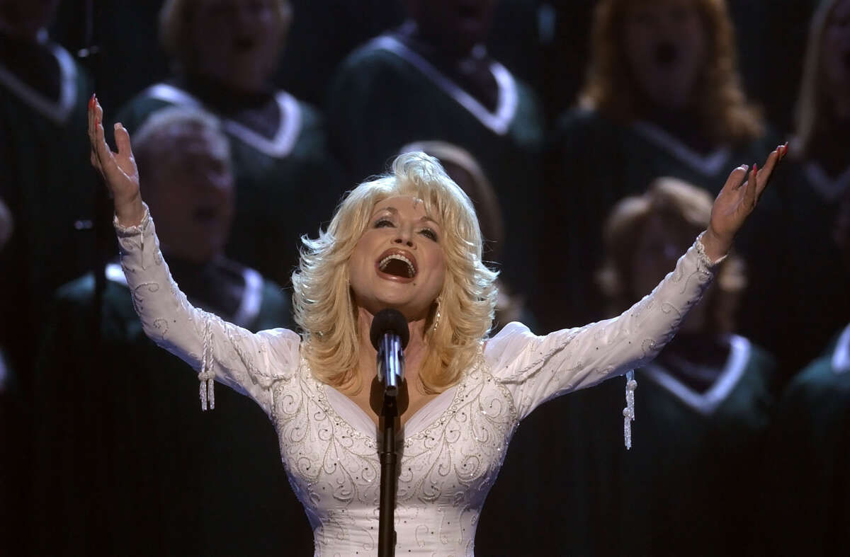 Dolly Parton performing in Nashville, Tenn., in 2002. (AP Photo/M. Spencer Green, File)