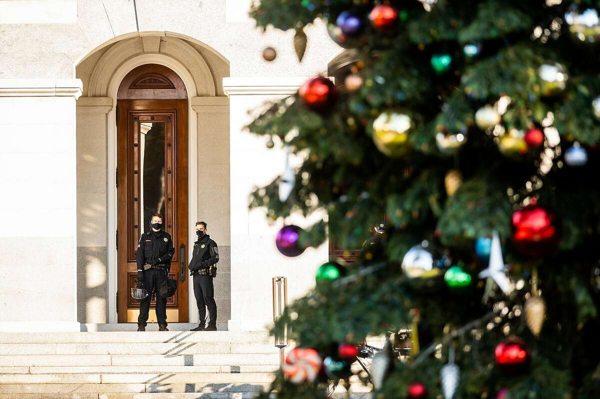 California Highway Parol officers stand watch outside the California State Capitol in Sacramento following a protest in support of President Trump on Jan. 6.