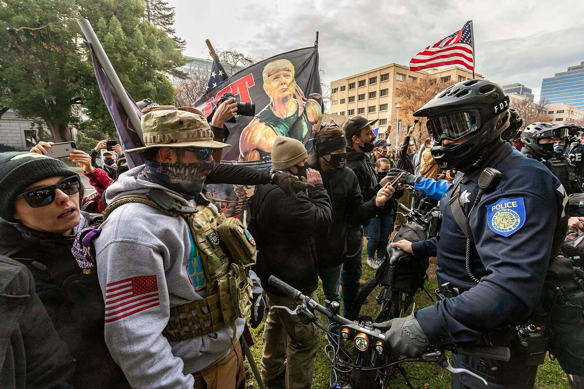 Supporters of President Trump face off against police at a rally in front of the California State Capitol building on Jan. 6.