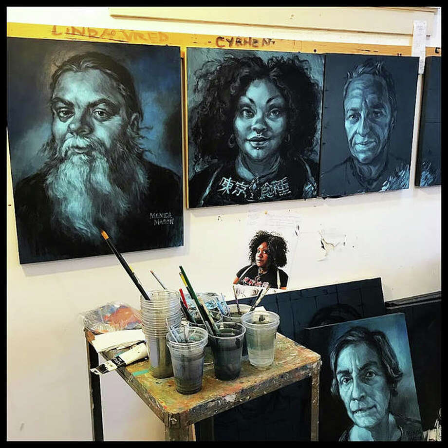 """The """"Eye Contact"""" exhibition in production. The exhibit is a continuation of the Community Portrait Project, by Alton artist Monica Mason. This exhibit will revisit some Mason's original portrayals in Community Portraits along with new portraits. Photo: For The Intelligencer"""