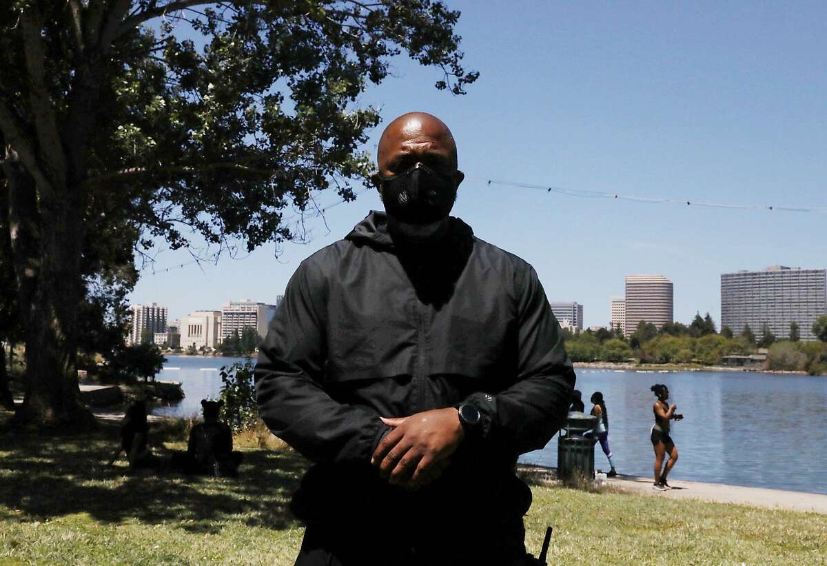 Tur-Ha Ak, founder of Oakland's Community Ready Corp, poses for a portrait near a tree where a fake body effigy was found hanging near Lakeshore and Wayne avenues along Lake Merritt in Oakland, Calif. Thursday, June 18, 2020. He calls for community members to join their lake patrol efforts and is unsure how this incident got past last night's patrols.