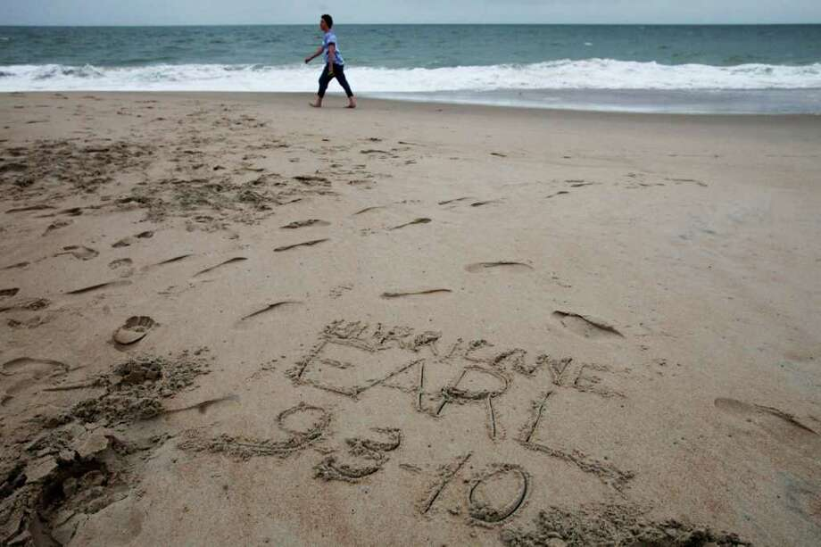 "As weather starts to move into the area, ""Hurricane Earl 9-3-10"" has been written on the beach at Rehoboth Beach, Del., on Friday, Sept. 3, 2010. (AP Photo/Jacquelyn Martin) Photo: Jacquelyn Martin, ASSOCIATED PRESS / Associated Press"