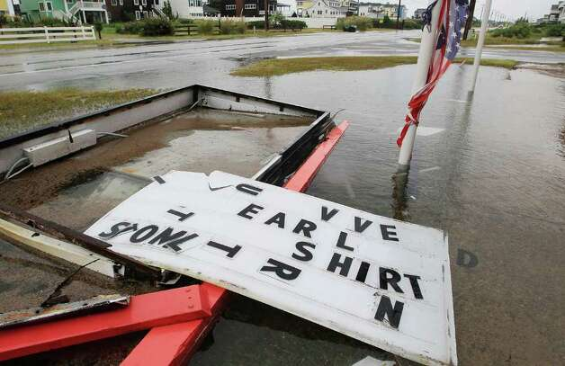 "NAGS HEAD, NC - SEPTEMBER 03: A sign that was advertising ""I Survived Earl T Shirts"" lies broken in front of a T shirt shop after Hurricane Earl on September 3, 2010 in Nags Head, North Carolina. Hurricane Earl was downgraded to a Category 2 before brushing the Outer Banks early Friday morning causing minimal damage.  (Photo by Mark Wilson/Getty Images) Photo: Mark Wilson, Getty Images / 2010 Getty Images"