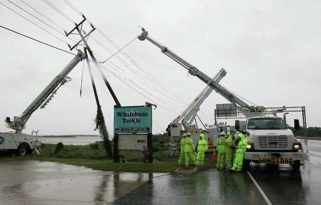 NAGS HEAD, NC - SEPTEMBER 03:  Power company crews prepare to straighten a pole that bent over due to the high winds of Hurricane Earl, on September 3, 2010 in Nags Head, North Carolina. Hurricane Earl was downgraded to a Category 2 before brushing the Outer Banks early Friday morning causing minimal damage.  (Photo by Mark Wilson/Getty Images) Photo: Mark Wilson, Getty Images / 2010 Getty Images