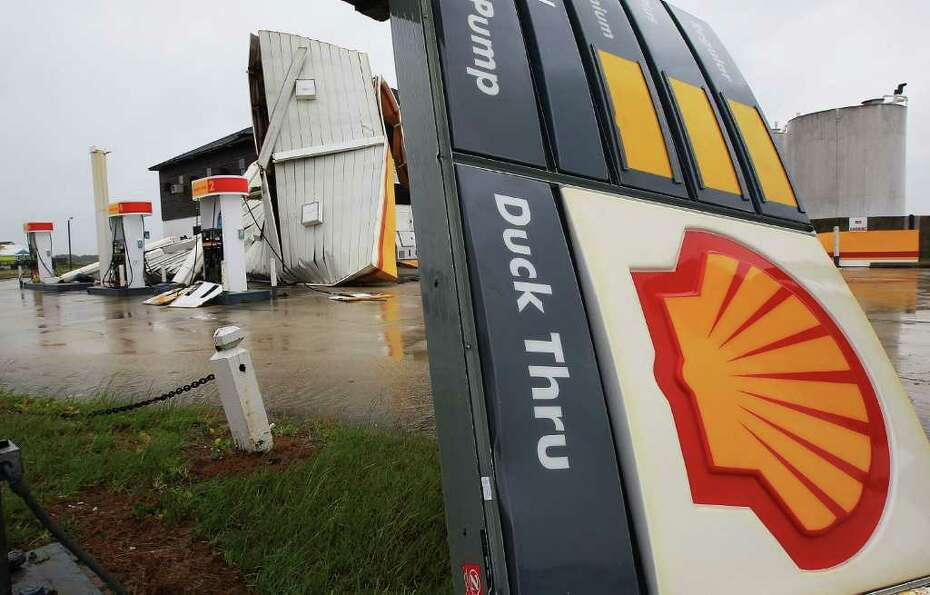 NAGS HEAD, NC - SEPTEMBER 03: A sign and overhang at a Shell gas station lies on the ground after th