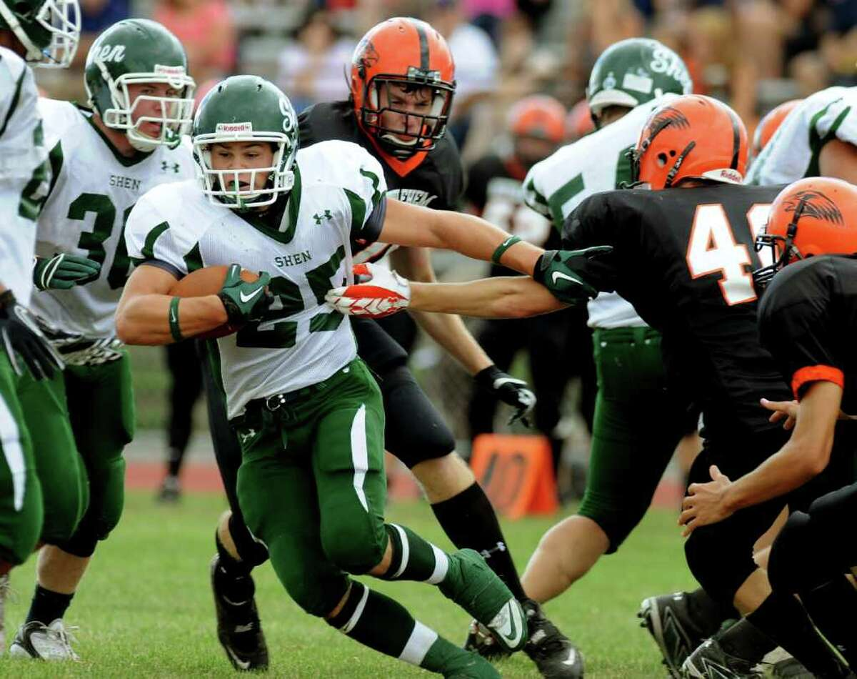 High school football -- Shenendehowa's Tony Fusco carries the ball through the Bethelehm defense. (Cindy Schultz / Times Union)