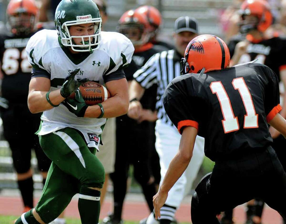 High school football -- Shenendehowa running back Tony Fusco gets ready to take on Bethlehem defender Steve Ingraham. (Cindy Schultz / Times Union)