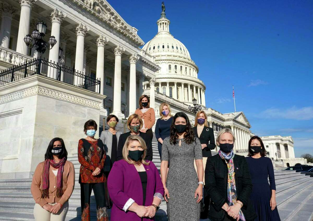 New Republican congresswomen pose for a portrait outside the Capitol on Dec. 3, 2020. They are Nicole Malliotakis, left, Yvette Herrell, Kat Cammack, Stephanie Bice, Victoria Spartz and Michelle Park Steel. In the back row: Young Kim, Claudia Tenny, Maria Elvira Salazar, Ashley Hinson and Beth Van Duyne.