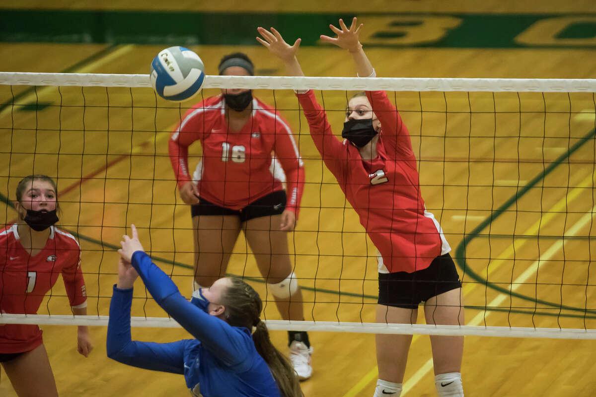 Beaverton's Becca Wirt jumps up to block the ball during the Beavers' state quarterfinal victory over Calumet Tuesday, Jan. 12, 2021 at Houghton Lake High School. (Katy Kildee/kkildee@mdn.net)