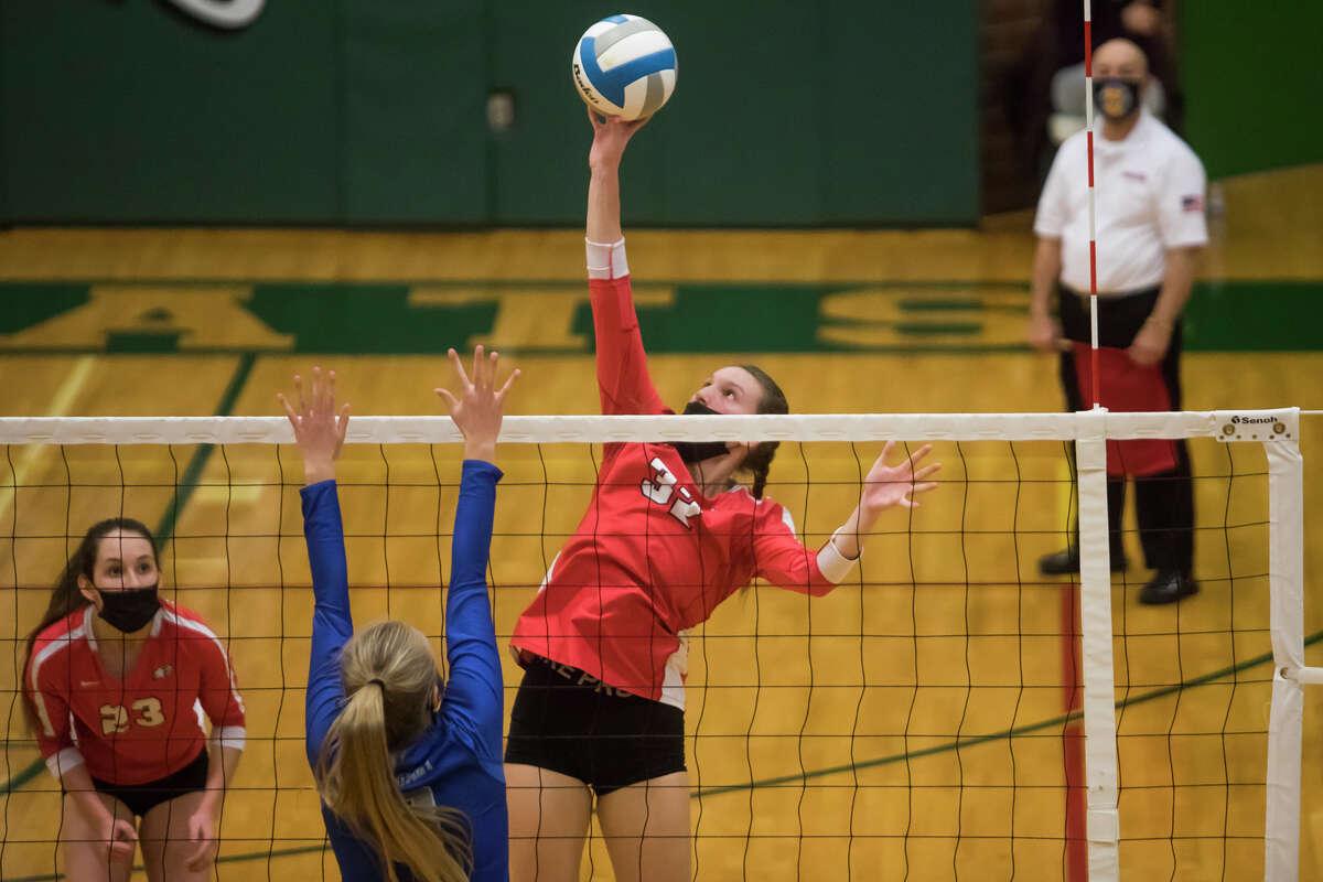 Beaverton's Molly Gerow spikes the ball during the Beavers' state quarterfinal victory over Calumet Tuesday, Jan. 12, 2021 at Houghton Lake High School. (Katy Kildee/kkildee@mdn.net)