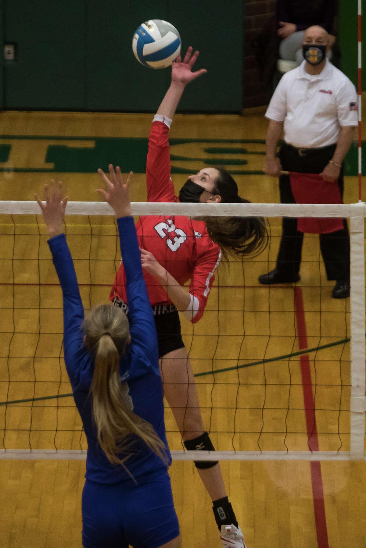 Beaverton's Hannah Stearns spikes the ball during the Beavers' state quarterfinal victory over Calumet Tuesday, Jan. 12, 2021 at Houghton Lake High School. (Katy Kildee/kkildee@mdn.net)