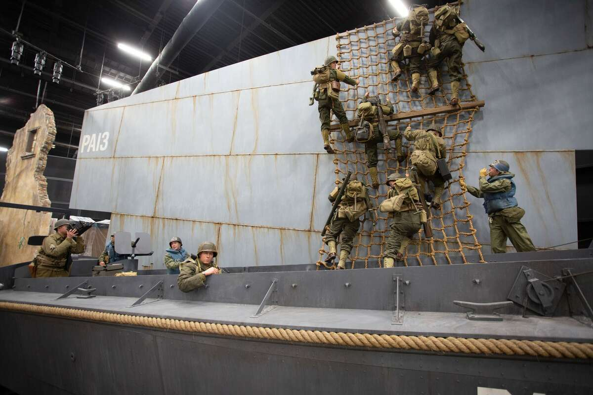 Three New York Army National Guard Soldiers posed for figures that inhabit this exhibit of a Higgins Boat landing craft loading up for the landings in Normandy on D-Day, June 6, 1944. Maj. Kevin Vilardo served as the model for the combat