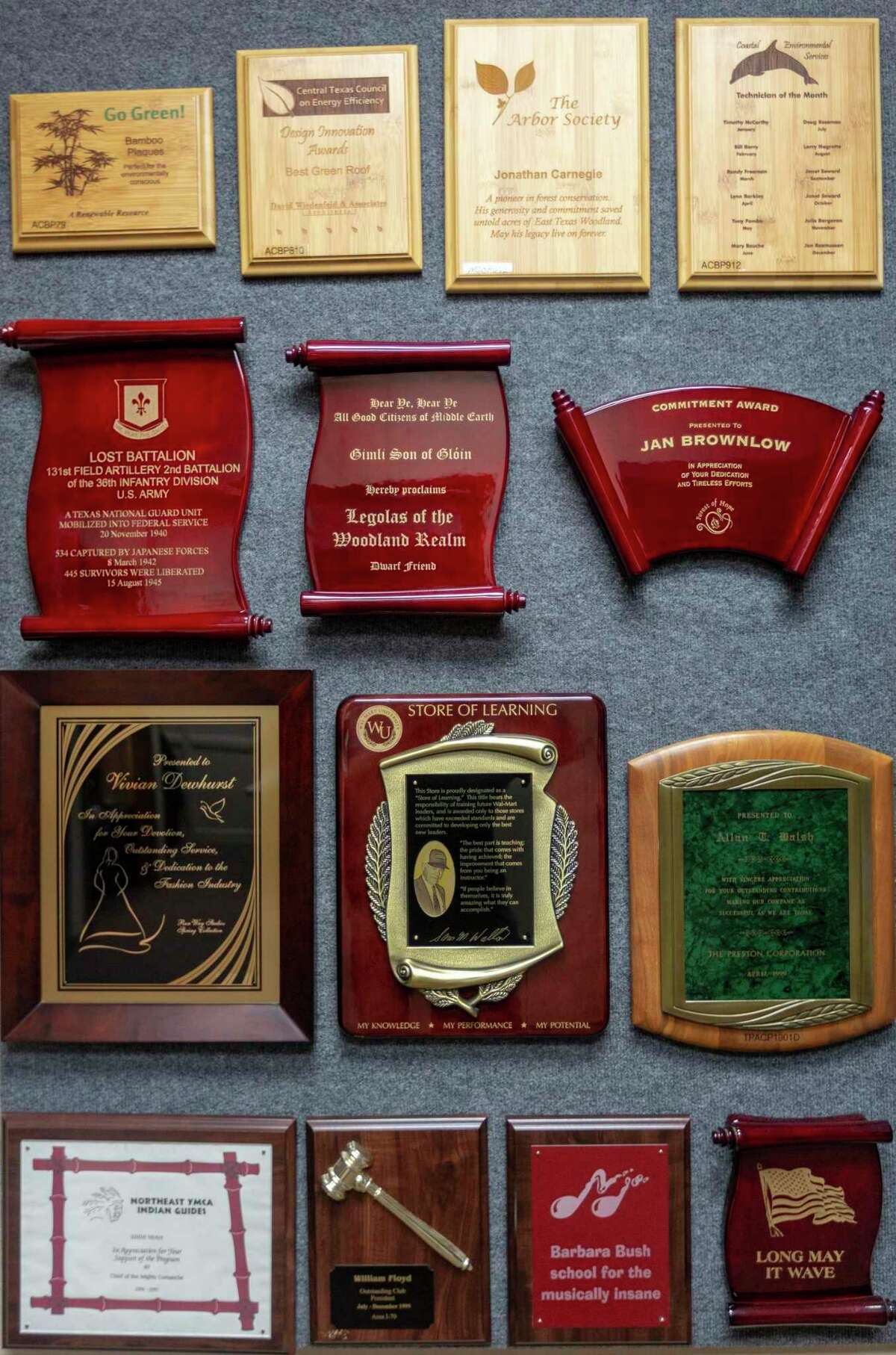 Some of the awards Skip Landry sells at Accolades Awards and Engraving, are seen Jan. 6, 2021 in his Rhapsody Drive-area business.