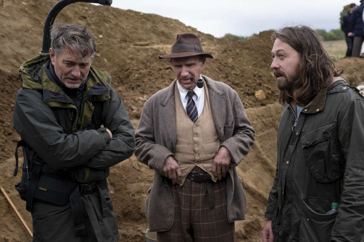 Director of photographer Mike Eley, director Basil Brown and star Ralph Fiennes on the set of