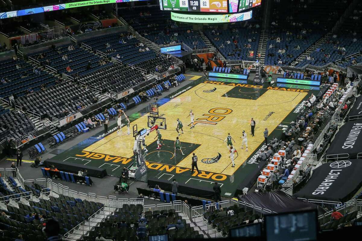 ORLANDO, FL - JANUARY 11: Empty seats are seen due to limited capacity restrictions during the pandemic in a NBA basketball game between the Milwaukee Bucks and Orlando Magic at Amway Center on January 11, 2021 in Orlando, Florida. NOTE TO USER: User expressly acknowledges and agrees that, by downloading and or using this photograph, User is consenting to the terms and conditions of the Getty Images License Agreement. (Photo by Alex Menendez/Getty Images)