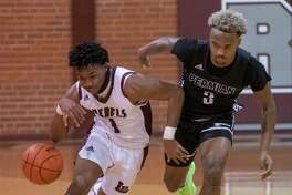 Lee High's Shemar Davis brings the ball downcourt as Permian's D'Shybreon Stephens Deary defends 01/12/2021 at the Lee High gym. Tim Fischer/Reporter-Telegram