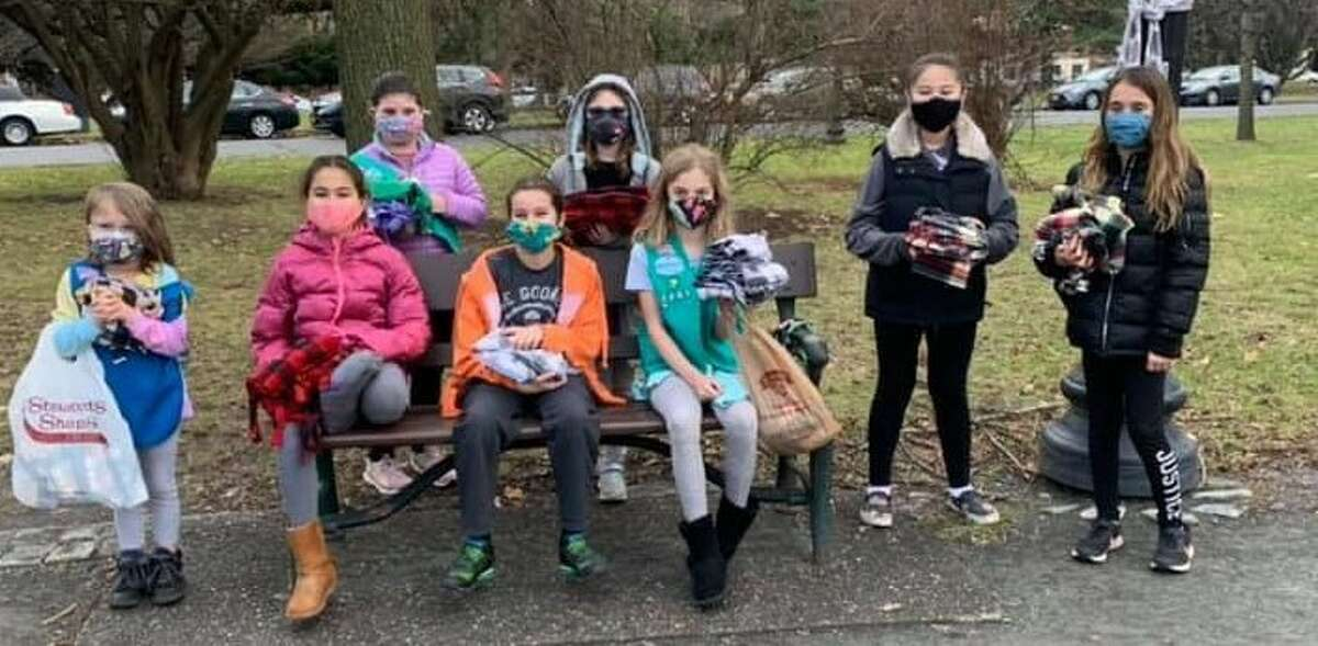 Girl Scouts of Northeastern New York Troop 1201 recently tied handmade scarves on trees throughout Washington Park in Albany for anyone in need of one during the cold winter months.They go out every year.