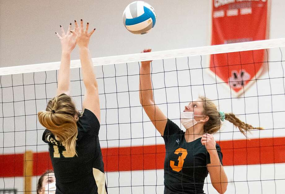 The Ubly varsity volleyball team saw its remarkable season come to an end on Tuesday night as the Bearcats fell to Auburn Hills Oakland Christian in the MHSAA state quarterfinals. / Kaitlin's Klicks