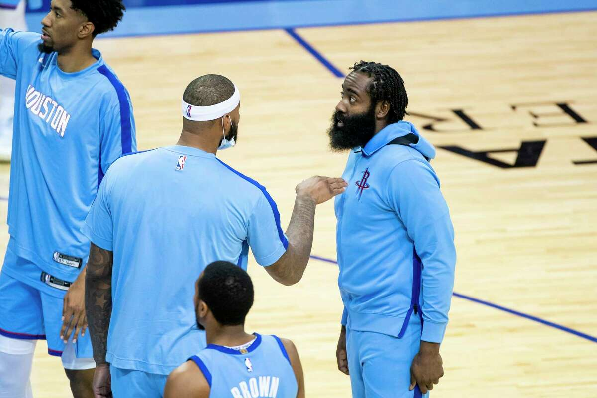 Houston Rockets guard James Harden (13) and center DeMarcus Cousins (15) talk before the start of the third quarter of an NBA game between the Houston Rockets and Los Angeles Lakers on Tuesday, Jan. 12, 2021, at Toyota Center in Houston.
