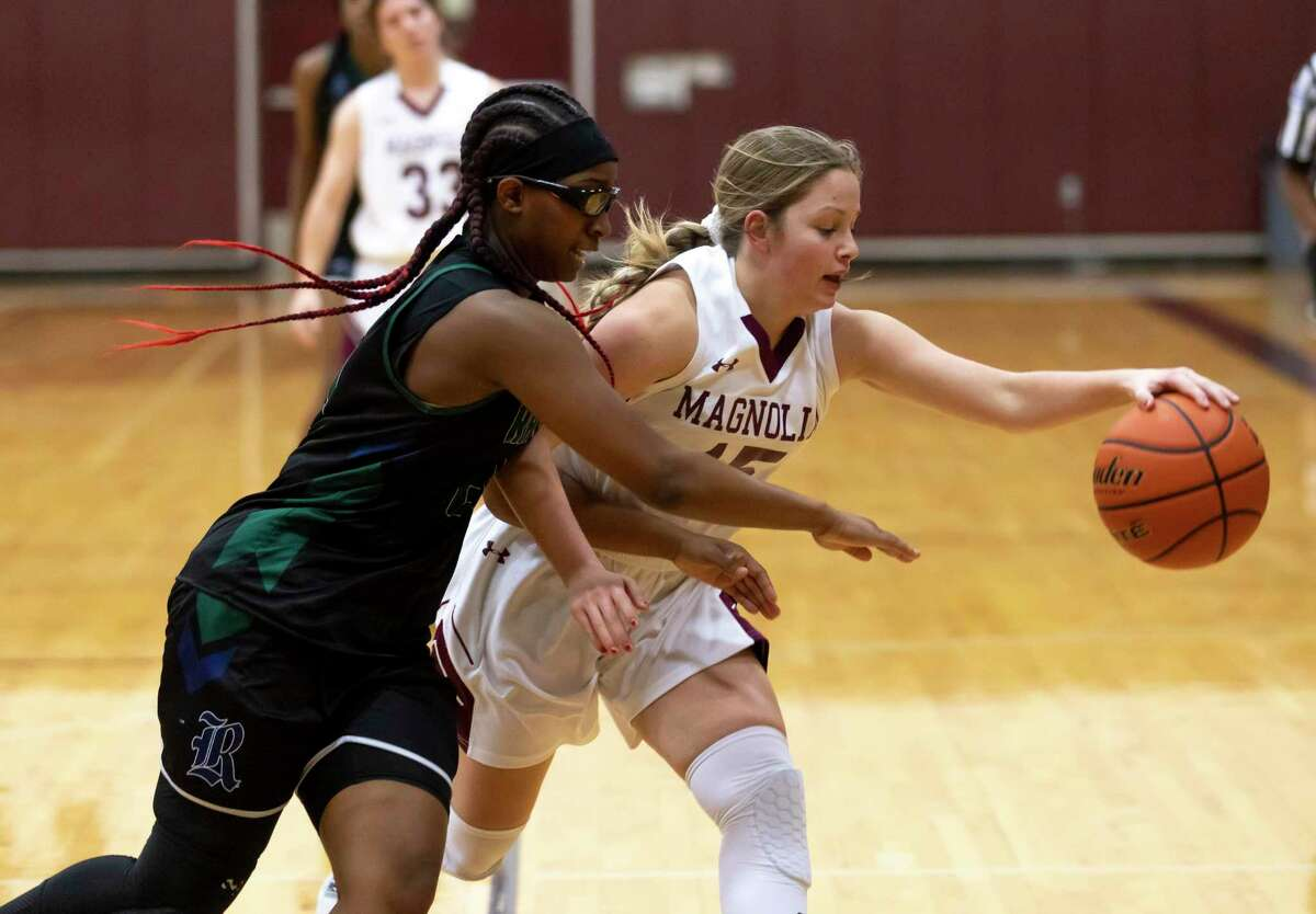 Magnolia guard Sydney Holland (15) loses control of the ball due to pressure from Bryan Rudder Tianna Mathis (20) during the first quarter of a District 19-5A girls basketball game at Magnolia High School, Tuesday, Jan 12, 2021, in Magnolia.