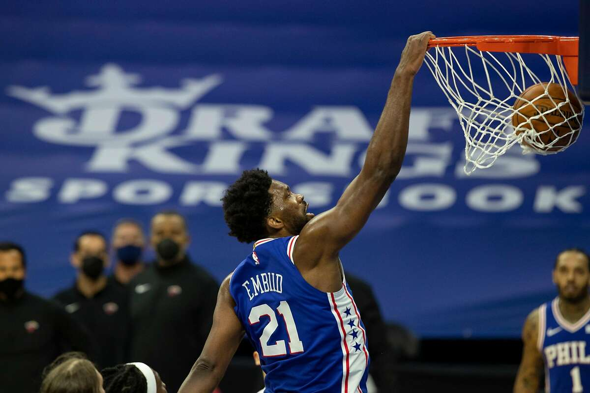 Joel Embiid of the 76ers dunks against the Miami Heat in the third quarter. He scored 45 points; his career high is 49.