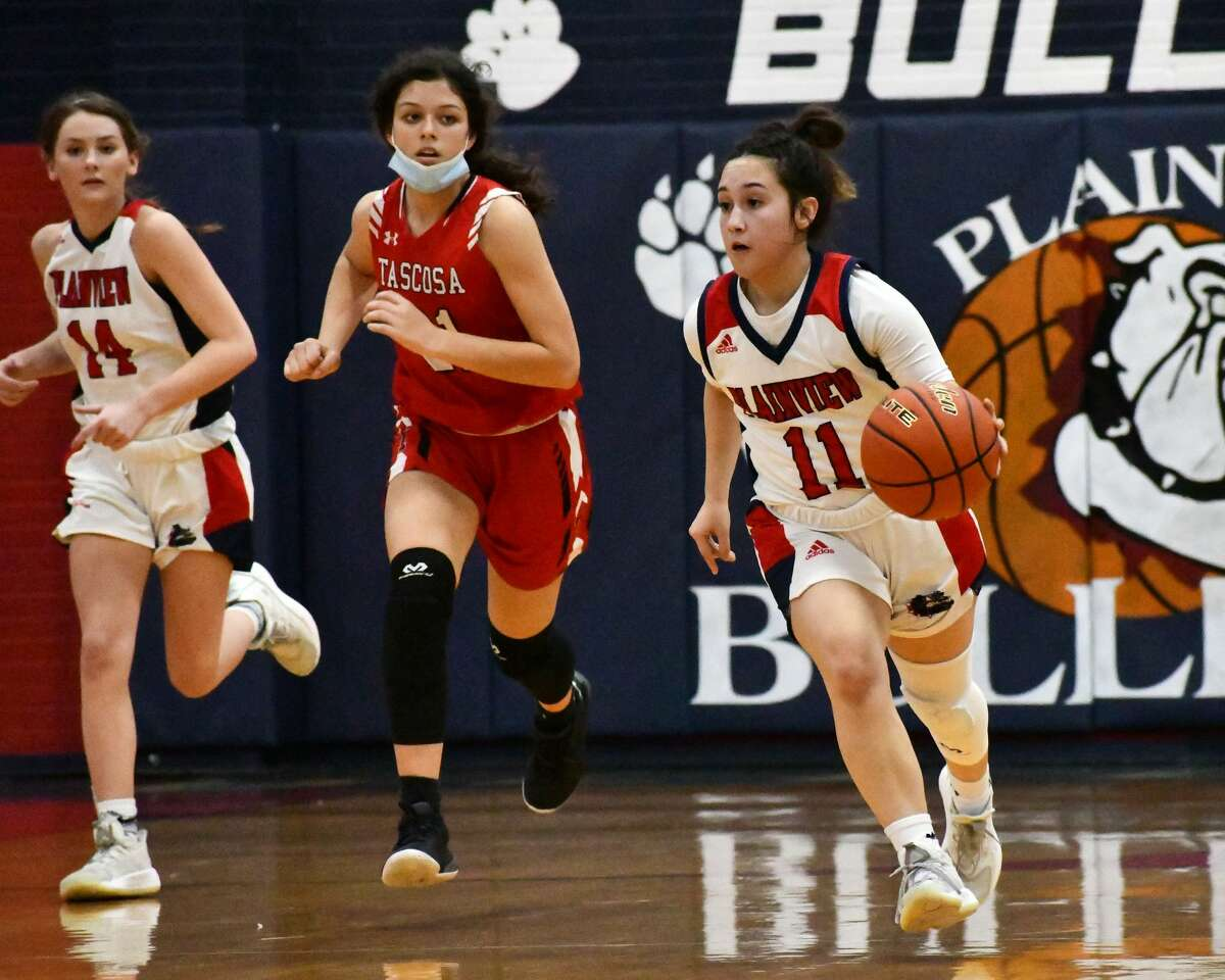 Plainview's Emily Sigala dribbles up the court on a fastbreak opportunity.