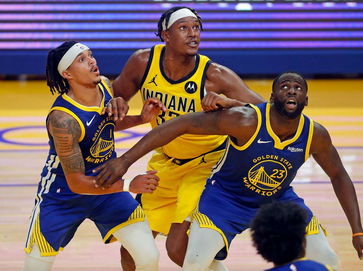 Golden State Warriors Draymond Green and Damion Lee box out Indiana's Myles Turner in the second quarter of a Jan. 12 game at Chase Center.